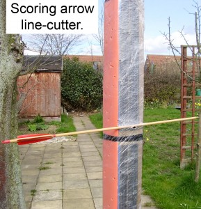 Scoring arrow line-cutter.