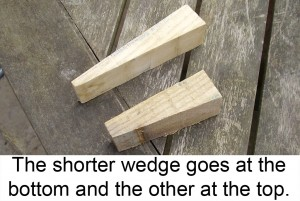 The shorter wedge goes at the bottom and the other at the top.